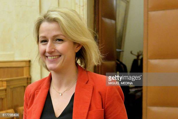 French Junior minister Barbara Pompili smiles during the second meeting of the new ecologist party 'Ecologistes' in Paris on March 26 2016 / AFP /...