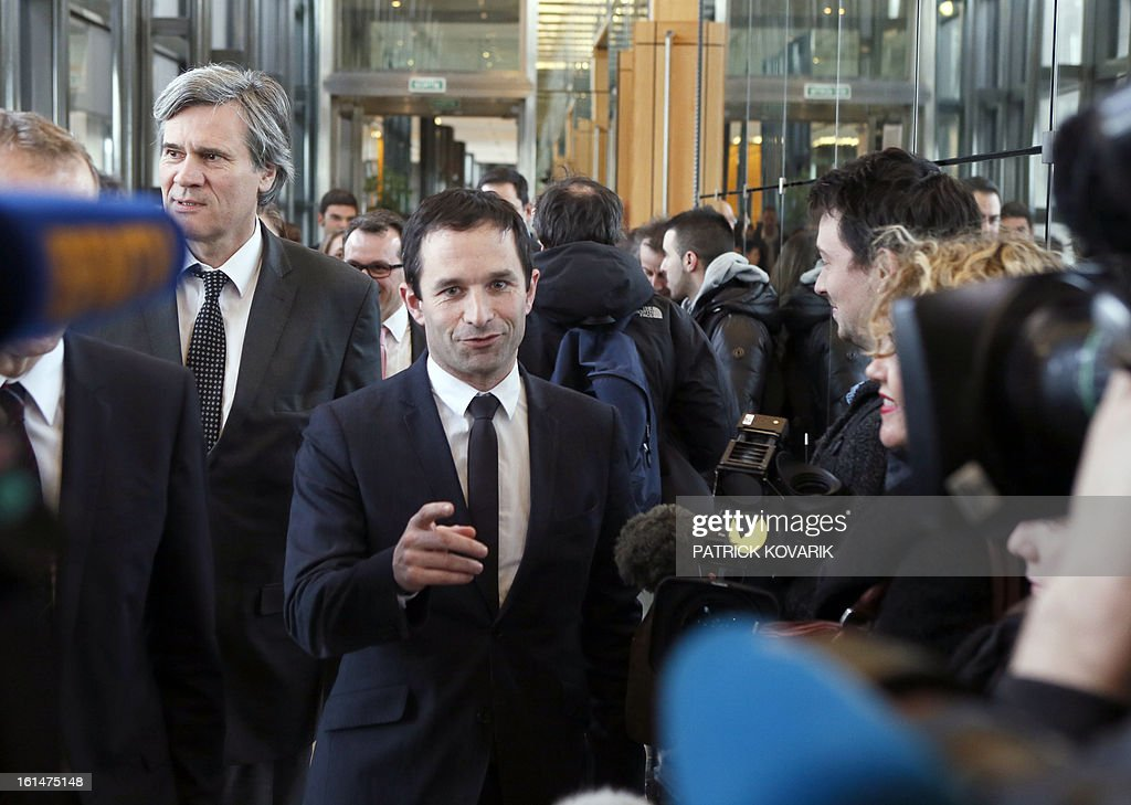 French Junior minister for Consumption Benoit Hamon (C) and French Agriculture minister Stephane Le Foll (L) answer journalists questions as they arrive for a meeting with representatives of the meat selling business in France , on February 11, 2013 in Paris. A Europe-wide food fraud scandal over horsemeat sold as beef deepened on February 9, as Romania announced an inquiry into the origin of the meat and suspicions of criminal activity mounted. AFP PHOTO PATRICK KOVARIK
