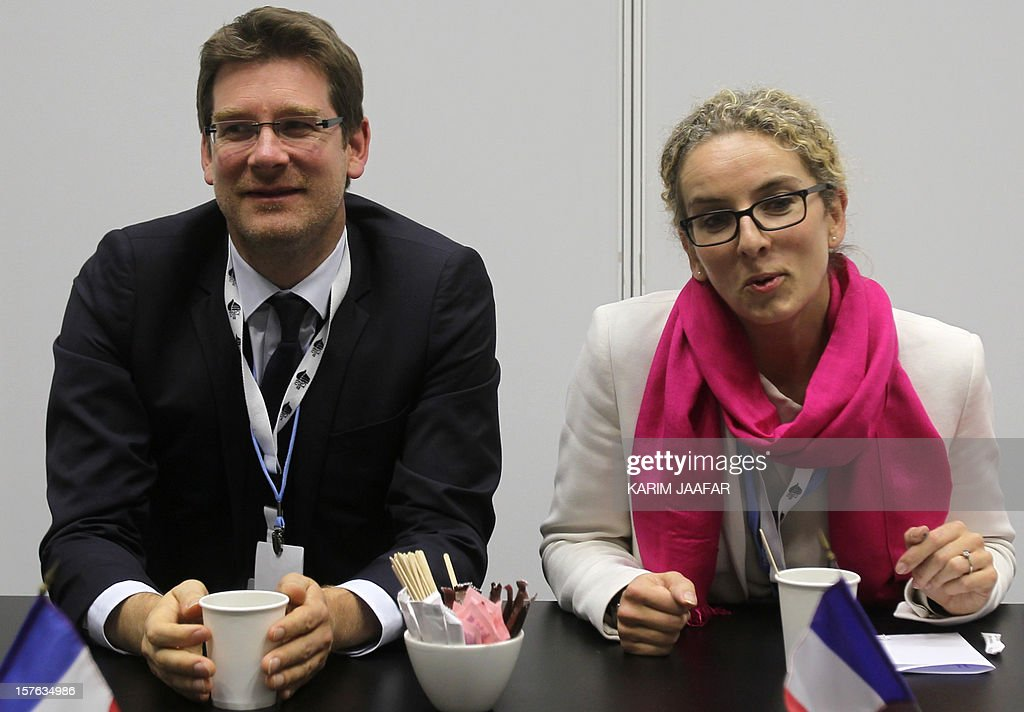 French junior Minister for Development Pascal Canfin (L) and French Ecology Minister Delphine Batho (R) talk to the media during a press conference on the sidelines of the United Nations climate conference in the Qatari capital Doha, on December 5, 2012. The European Union and United States said they would not make concrete near-term funding pledges at UN climate talks to help developing countries cope with the fallout from global warming.