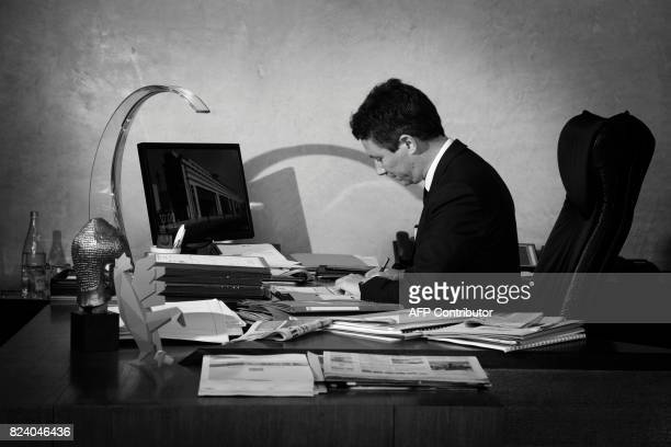 French Junior Minister for Economy Benjamin Griveaux is pictured during a photo session in his office at the Economy ministry on July 28 2017 in...
