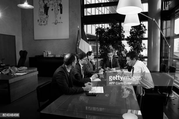 French Junior Minister for Economy Benjamin Griveaux is pictured during a meeting within a photo session in his office at the Economy ministry on...