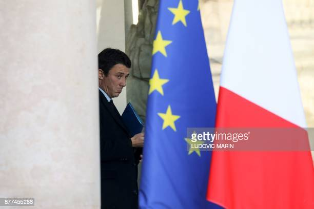 French Junior Minister for Economy Benjamin Griveaux looks on as he leaves the Elysee presidential palace after the weekly cabinet meeting on...