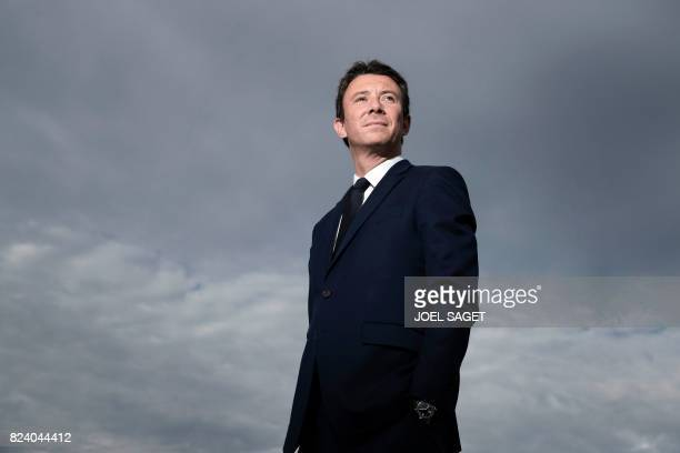 French Junior Minister for Economy Benjamin Griveaux poses during a photo session on the heliport of the Economy ministry on July 28 2017 in Paris /...