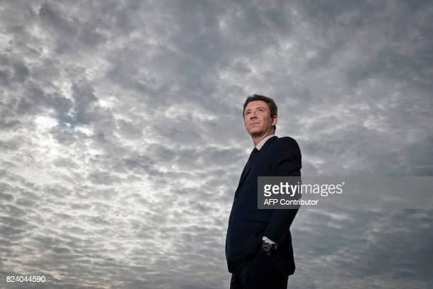 TOPSHOT French Junior Minister for Economy Benjamin Griveaux poses during a photo session on the heliport of the Economy ministry on July 28 2017 in...