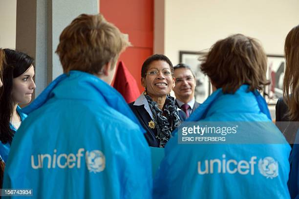 French Junior Minister for Educational Success George PauLangevin talks to pupils wearing UNICEF jackets at the Duruy college for the International...