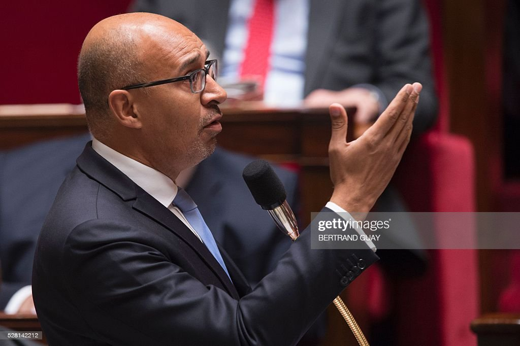 French Junior Minister for European Affairs Harlem Desir delivers a speech during a session of Questions to the government, on May 4, 2016 at the French National Assembly in Paris. / AFP / BERTRAND