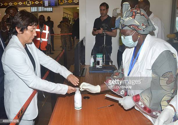 French Junior minister for French speaking countries Annick Girardin takes part in a health inspection upon her arrival at the Conakry airport in...
