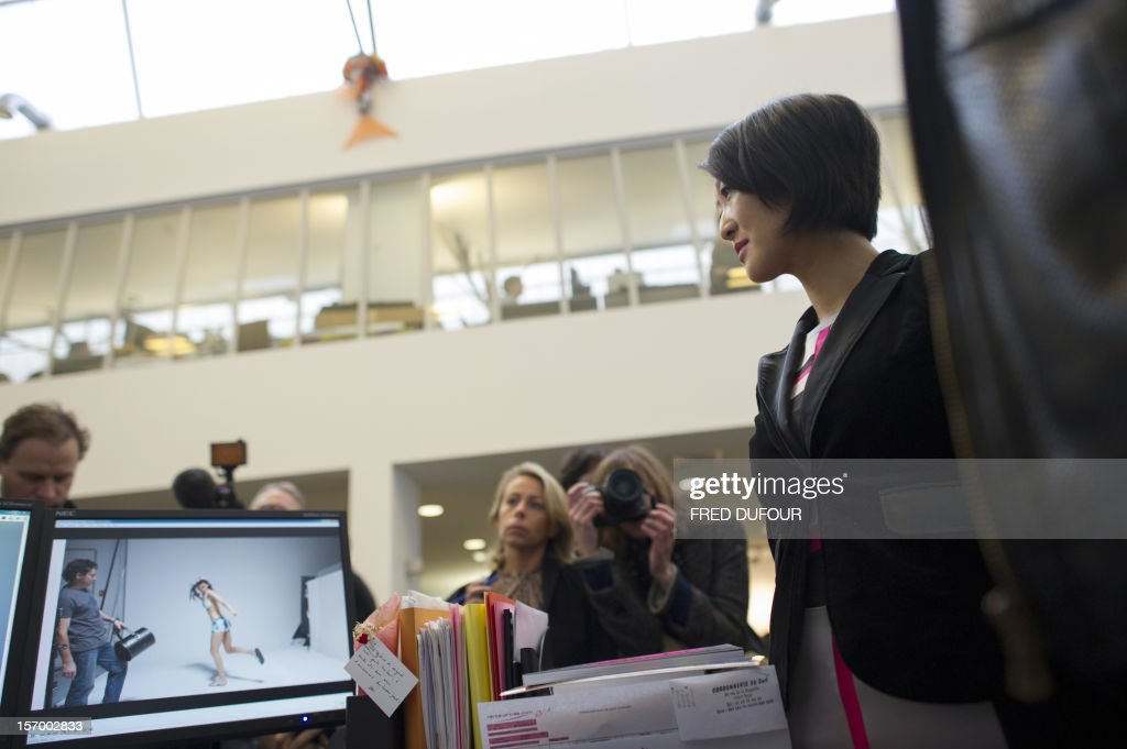 French Junior Minister for SMEs, Innovations and Digital Economy Fleur Pellerin (foreground) listens as she makes a tour of the vente-privee.com headquarters in Saint-Denis, north of Paris, on November 27, 2012 ahead of the Christmas and new Year celebrations. The vente-privee.com storage facilities celebrates its 10th anniversary