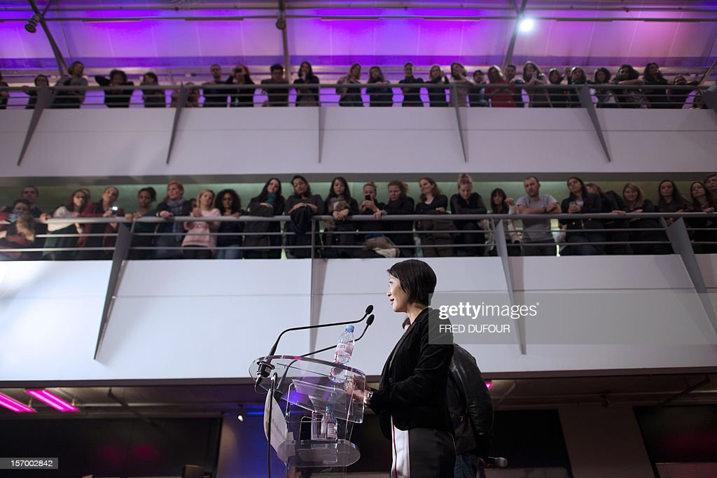French Junior Minister for SMEs, Innovations and Digital Economy Fleur Pellerin (foreground) delivers a speech as she visits the vente-privee.com headquarters in Saint-Denis, north of Paris, on Nov...