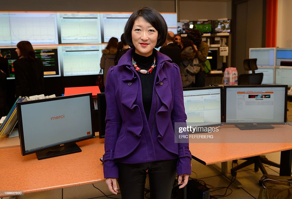 French Junior Minister for SMEs, Innovations and Digital Economy, Fleur Pellerin visits the Orange mobile supervision center few hours before the New Years eve celebrations on December 31, 2012 in Paris.