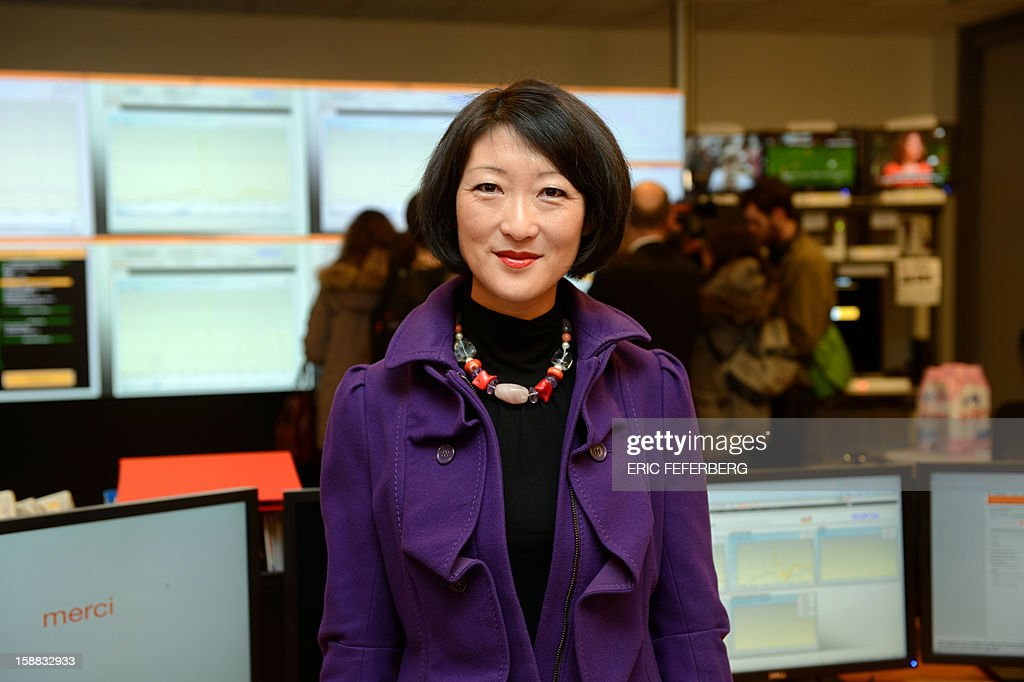 French Junior Minister for SMEs, Innovations and Digital Economy, Fleur Pellerin visits the Orange mobile supervision center few hours before the New Years eve celebrations on December 31, 2012 in Paris. AFP PHOTO /ERIC FEFERBERG
