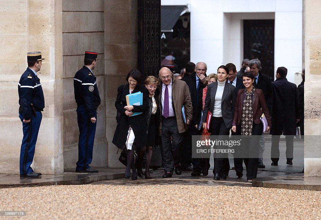 French Junior Minister for SMEs, Innovations and Digital Economy Fleur Pellerin, French Junior minister for Decentralization Anne Marie Escoffier, Employment and Social Dialogue Minister Michel Sapin, Minister for Culture and Communication Aurelie Filippetti, Minister for Women's Rights and Government Spokesperson Najat Vallaud-Belkacem arrive at the Elysee Palace in Paris, on January 3, 2013 for the president's traditional new year wishes after the first cabinet meeting of the year.
