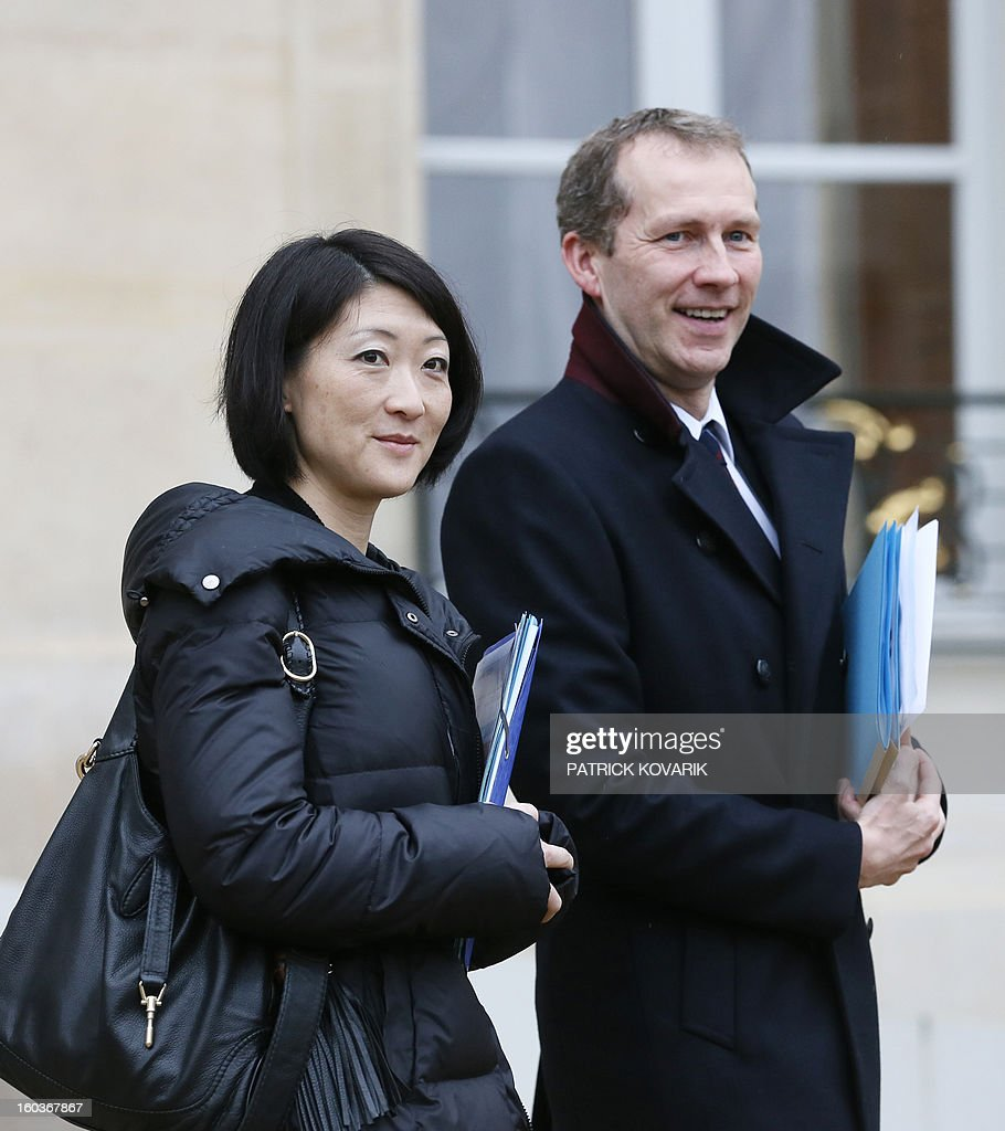 French Junior Minister for SMEs, Innovations and Digital Economy, Fleur Pellerin, and French Junior Minister for Agriculture, Agribusiness and Forest, Guillaume Garot, leave the Elysee presidential Palace after the weekly cabinet meeting on January 30, 2013 in Paris.