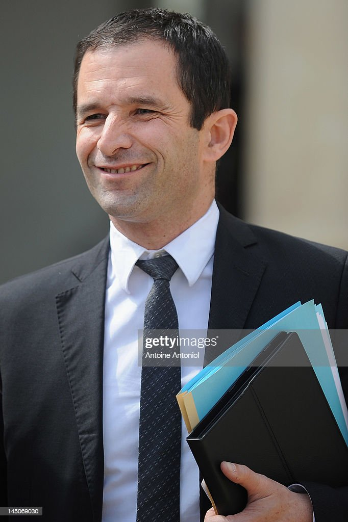 French Junior Minister for Social and Solidarity Economy, <a gi-track='captionPersonalityLinkClicked' href=/galleries/search?phrase=Benoit+Hamon&family=editorial&specificpeople=2143789 ng-click='$event.stopPropagation()'>Benoit Hamon</a> leaves the weekly cabinet meeting at Elysee Palace on May 23, 2012 in Paris, France. This is the second meeting since the government was appointed May 16.