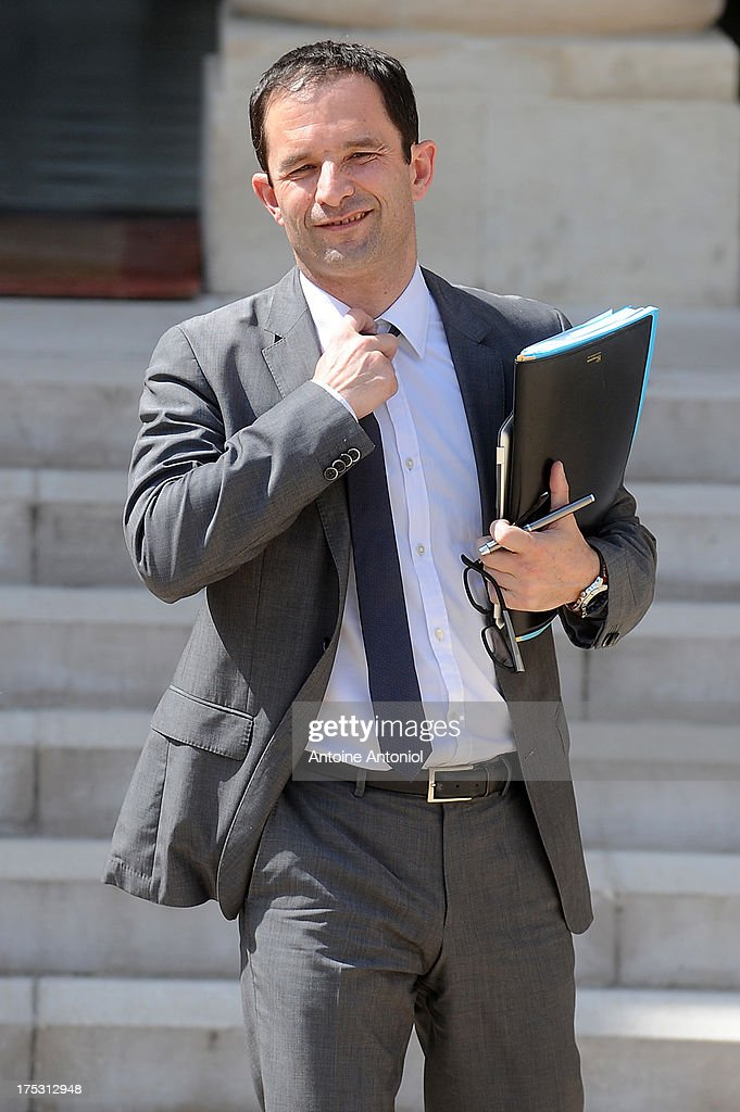 French Junior Minister for Social and Solidarity Economy <a gi-track='captionPersonalityLinkClicked' href=/galleries/search?phrase=Benoit+Hamon&family=editorial&specificpeople=2143789 ng-click='$event.stopPropagation()'>Benoit Hamon</a> leaves Elysee Palace after attending the weekly cabinet meeting August 2, 2013 in Paris, France. Today was the last weekly cabinet meeting before summer holidays.