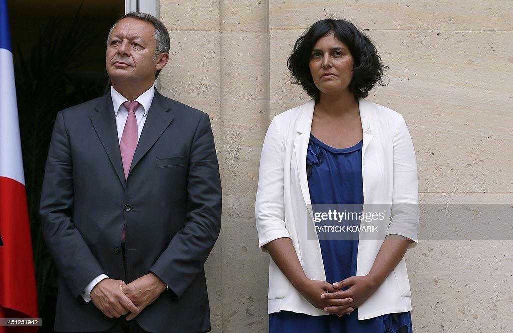 French Junior Minister for Sports Thierry Braillard (L) and French Junior minister for Urban Affairs Myriam El Khomri pose during a handover ceremony on August 27, 2014 in Paris.