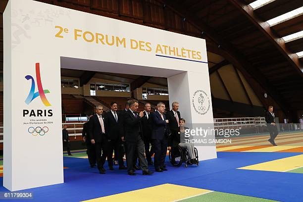 French junior minister for Sports Thierry Braillard International Olympic Committee president Thomas Bach IOC French member Guy Drut and President of...