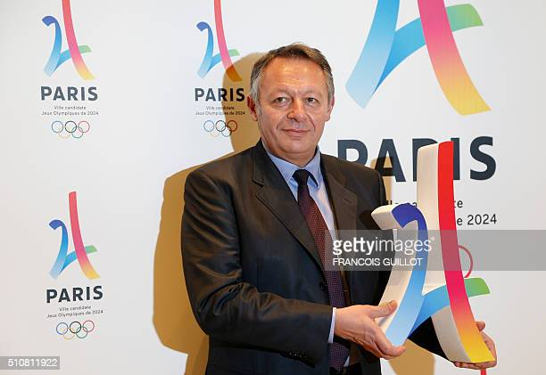 French junior Minister for Sports Thierry Braillard poses with the logo of Paris as candidate for the 2024 Olympic summer games during a press...