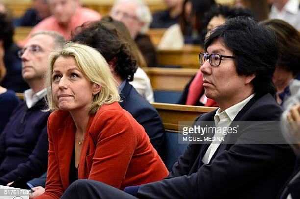 French Junior Minister for State reform and Simplification JeanVincent Place looks on next to French Junior minister Barbara Pompili during the...