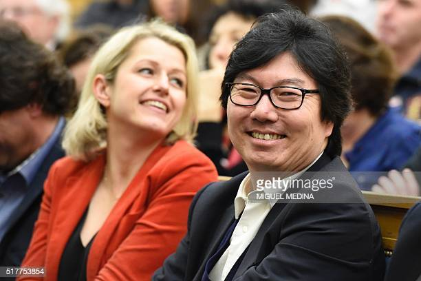 French Junior Minister for State reform and Simplification JeanVincent Place smiles next to French Junior Minister Barbara Pompili during the second...