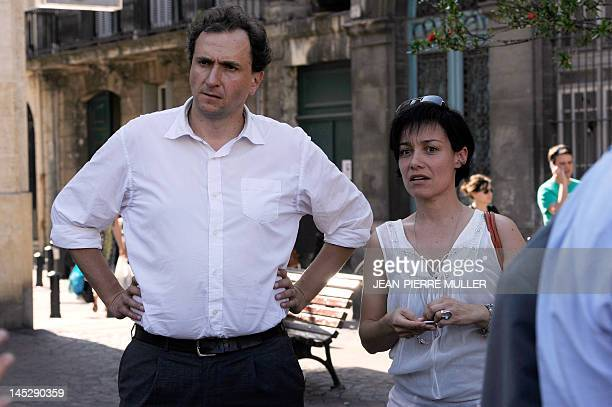 French Junior Minister for the Elderly and Disabled susbitute Vincent Feltesse next to Emmanuelle Ajon poses following a distribution of campaign...