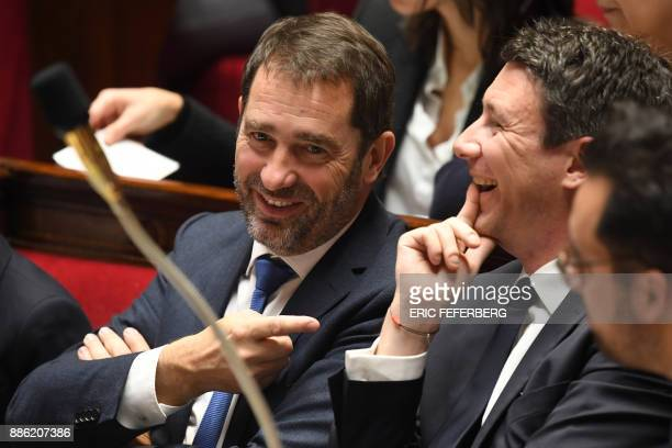 French Junior Minister for the Relations with Parliament Christophe Castaner shares a laugh with French Government's Spokesperson Benjamin Griveaux...