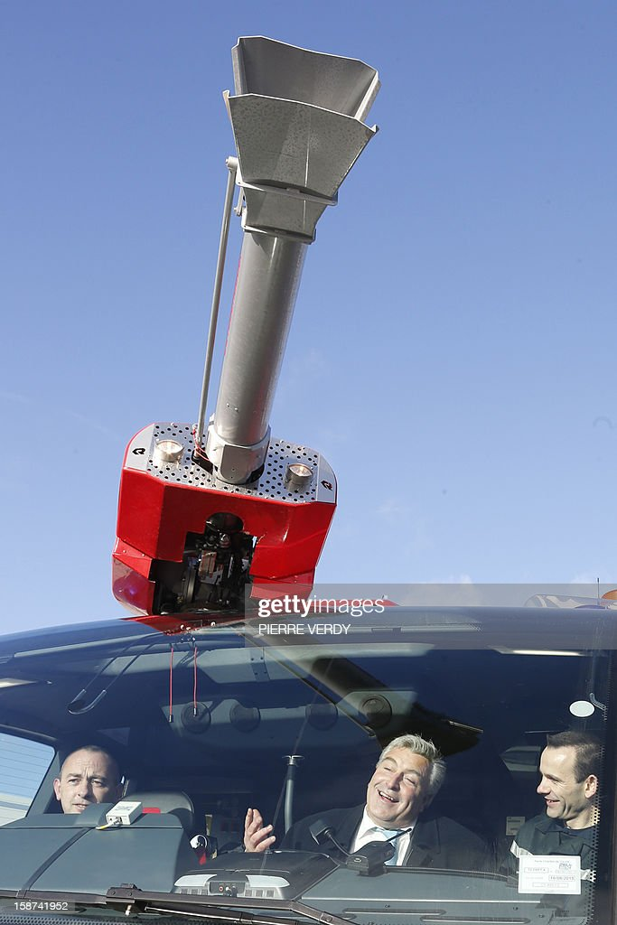 French Junior minister for Transports and Maritime Economy Frederic Cuvillier (C) visits the Charles-de-Gaulle airport with firemen on December 27, 2012 in Roissy-en-France.