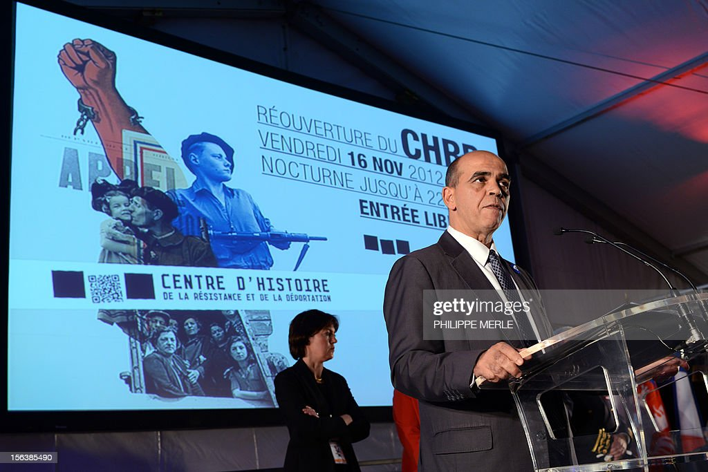 French Junior Minister for Veterans, Kader Arif (R) delivers a speech on November 14, 2012 at the Centre of History of French Resistance and Deportation (CHRD) in Lyon, eastern France, two days ahead of its reopening after a one-year revamp. AFP PHOTO PHILIPPE MERLE
