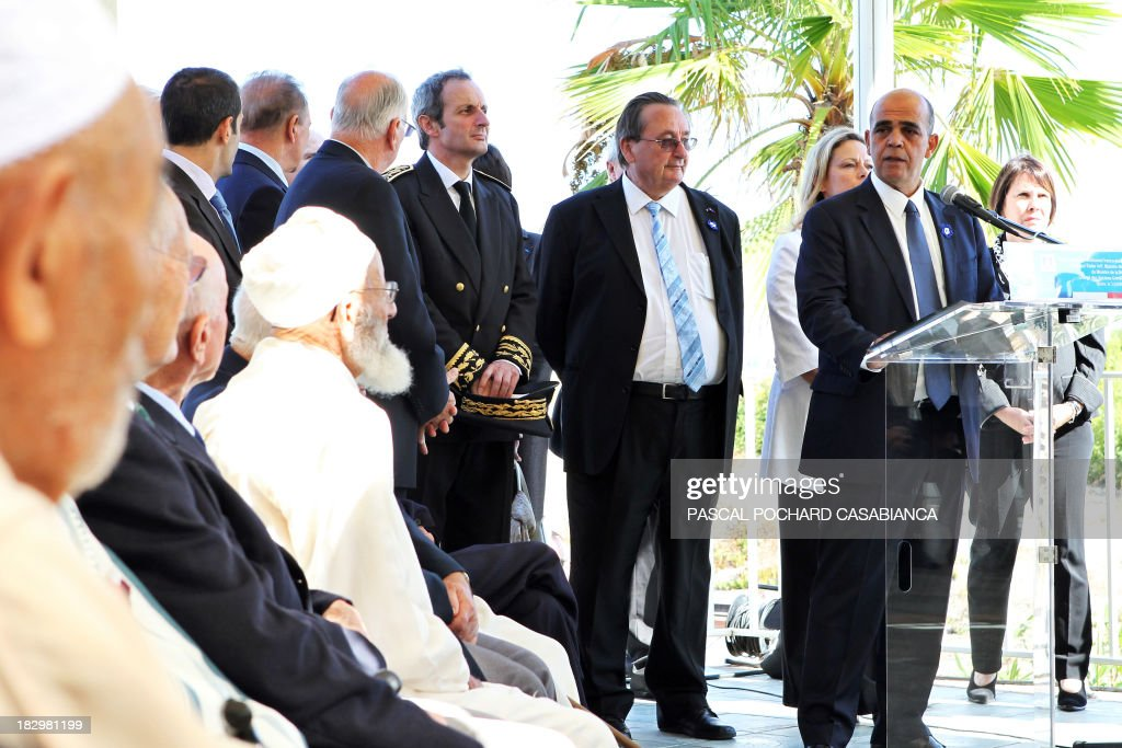 French Junior minister for Veterans Kader Arif (R) delivers a speech beside Moroccan war veterans, who served as 'Moroccan Goumiers' in the French Army of Africa during WWII, on October 3, 2013 in Bastia during an award ceremony marking the 70th anniversary of the liberation of the French island of Corsica in the Mediterranean Sea. AFP PHOTO / PASCAL POCHARD-CASABIANCA