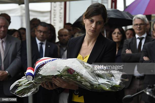 French junior minister for victims aid Juliette Meadel lays a wreath at the railway station of BretignysurOrge on July 12 2016 as part of the...