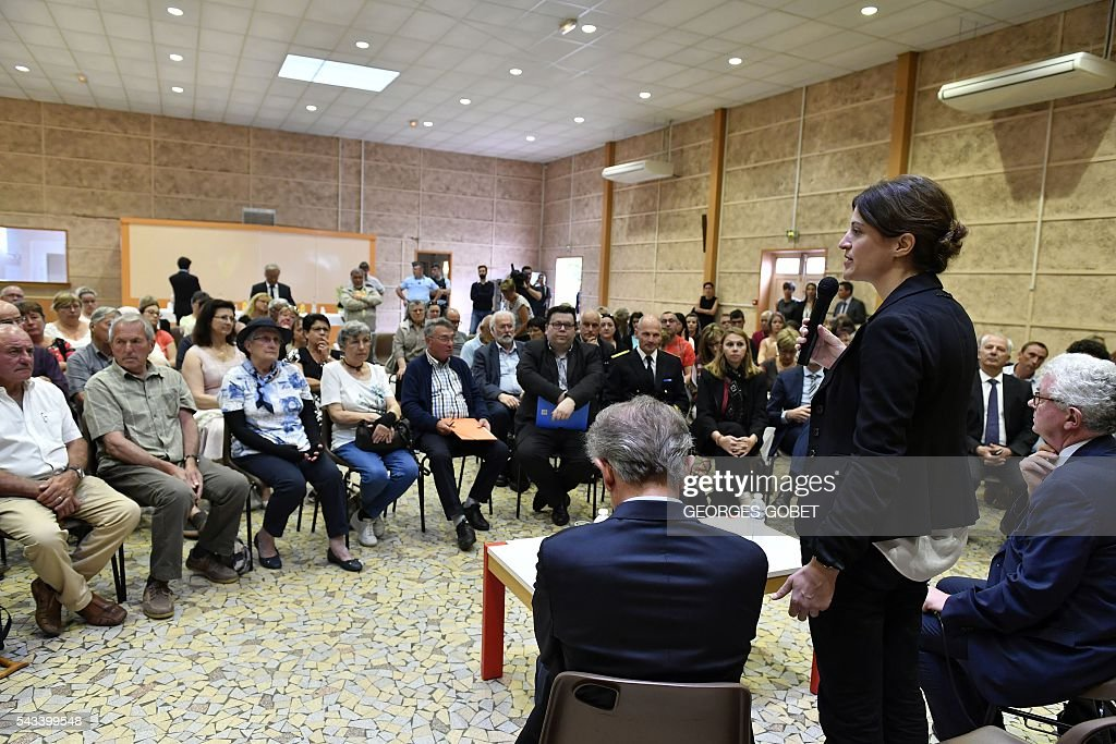 French Junior Minister for Victims Aid Juliette Meadel speaks to relatives of the victims of the road accident where a coach carrying elderly day-trippers collided with a lorry, killing 43 people on October 23, 2015 near the village of Puisseguin, on June 28, 2016 in Puisseguin after the signature of the amicable agreement the compensation. The majority of the beneficiaries of the 43 killed persons during the accident, will receive a compensation of 11 millions euros from the insurances, announced their lawyers on June 28, 2016. / AFP / GEORGES