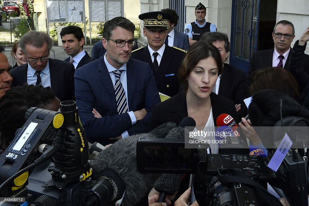 French Junior Minister for Victims Aid Juliette Meadel (R) speaks to the press after signing on June 28, 2016 in Puisseguin an amicable agreement on the compensation for relatives of the victims of the road accident where a coach carrying elderly day-trippers collided with a lorry that killed 43 people on October 23, 2015 near the village of Puisseguin. The majority of the beneficiaries of the 43 killed persons during the accident, will receive a compensation of 11 millions euros from the insurances, announced their lawyers on June 28, 2016. / AFP / GEORGES