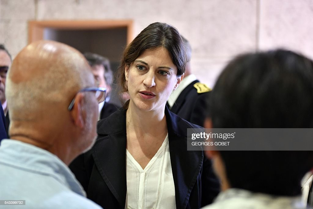 French Junior Minister for Victims Aid Juliette Meadel speaks with relatives of the victims of the road accident where a coach carrying elderly day-trippers collided with a lorry, killing 43 people on October 23, 2015 near the village of Puisseguin, on June 28, 2016 in Puisseguin after the signature of the amicable agreement the compensation. The majority of the beneficiaries of the 43 killed persons during the accident, will receive a compensation of 11 millions euros from the insurances, announced their lawyers on June 28, 2016. / AFP / GEORGES