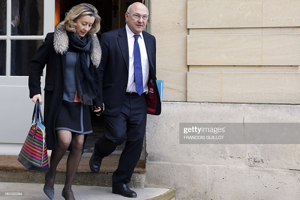 French Junior Minister in charge of French nationals abroad Helene Conway-Mouret (L) and French Labour, Employment and Social Dialogue Michel Sapin leave following a lunch with French Prime Minister and French government's ministers focused on budget on February 20, 2013 at the Hotel Matignon, the Prime Minister official residence, in Paris. AFP PHOTO / FRANCOIS GUILLOT
