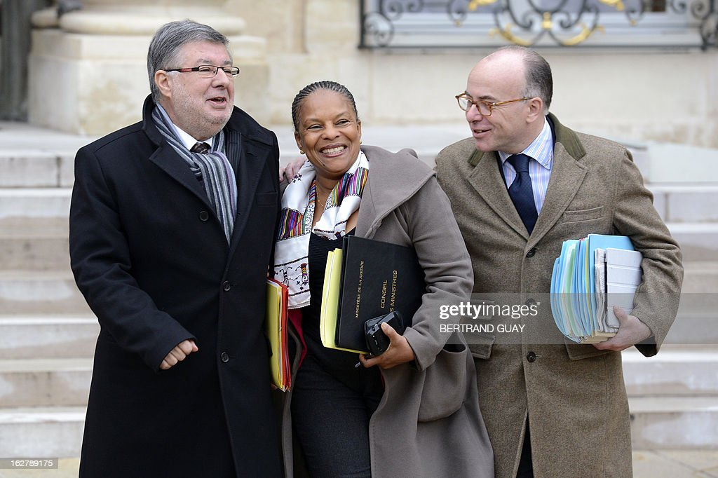 French Junior Minister in Charge of Relations with the Parliament, Alain Vidalies, French Justice Minister Christiane Taubira and French Junior Minister for European Affairs, Bernard Cazeneuve leave the Elysee Presidential Palace in Paris on February 27, 2013, at the end of the weekly cabinet meeting.