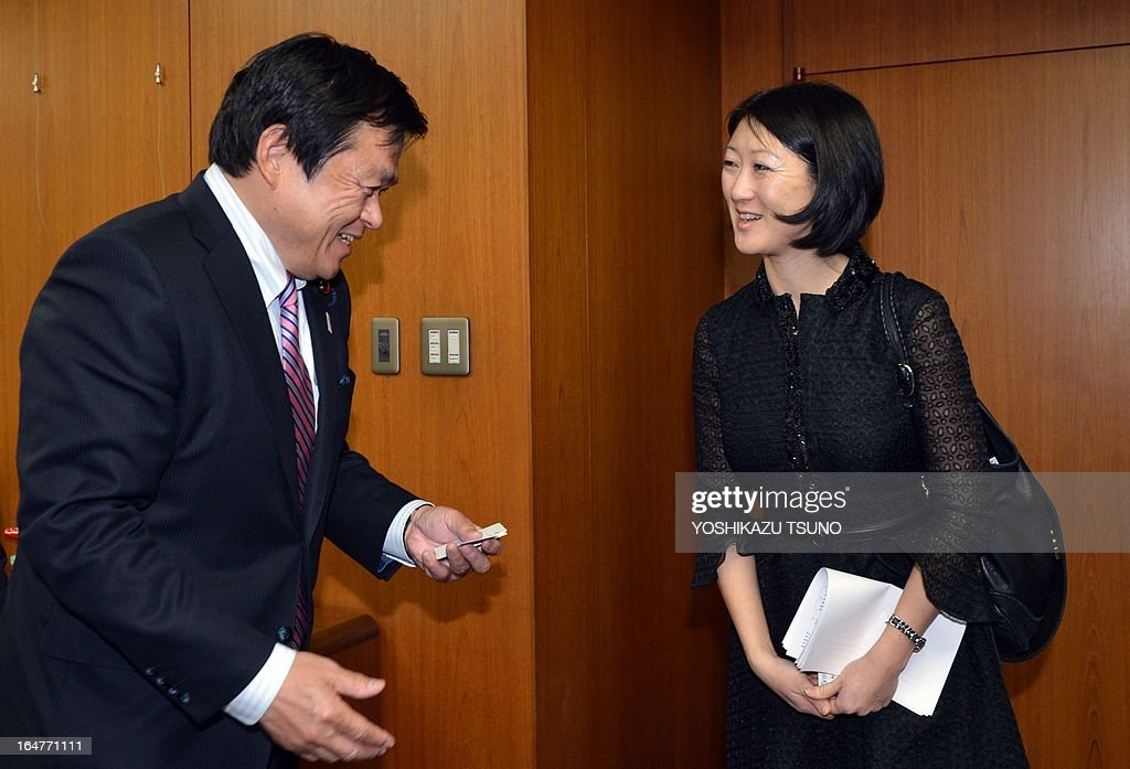 French Junior Minister in charge of small and medium enterprises and the digital economy Fleur Pellerin (R) is greeted by Japanese Vice Minister of Economy, Trade and Industry Kazuyoshi Akaba for their talks at Akaba's office in Tokyo on March 28, 2013. Pellerin is on a three-day visit to Japan. AFP PHOTO / Yoshikazu TSUNO