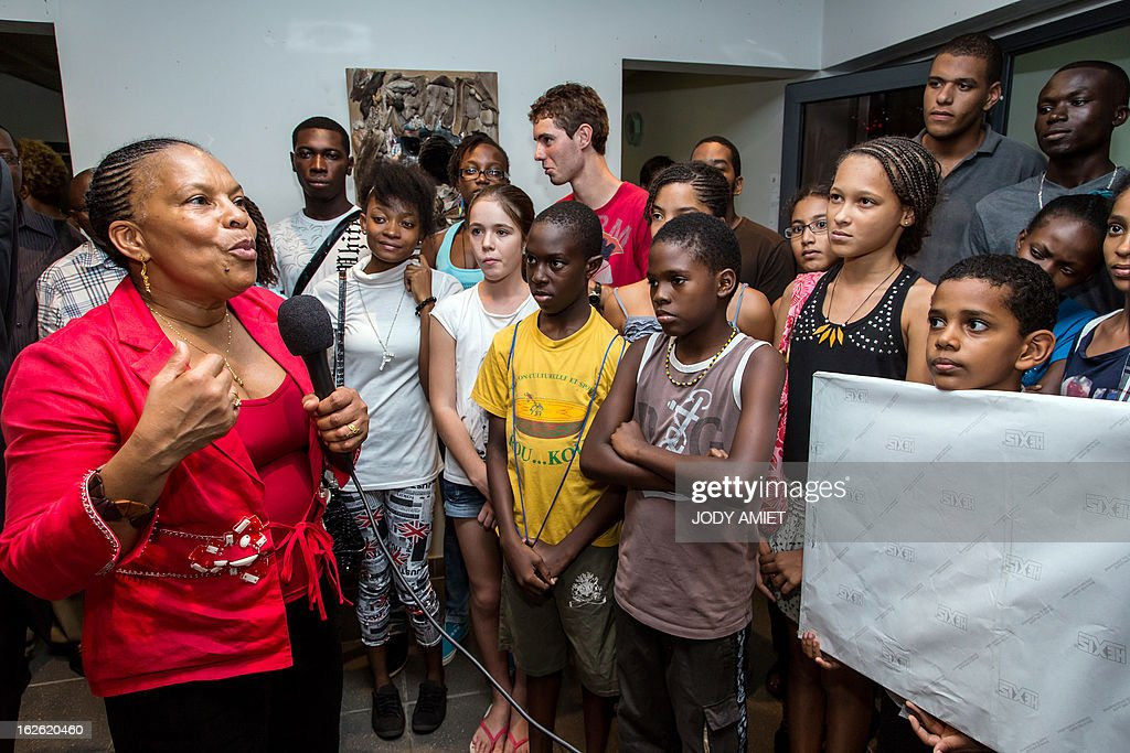 French Justice minister Christiane Taubira (L) addresses children involved in 'Kourou Television' programm, on February 23, 2013 during a meeting at Kourou's city hall, as part of her five-day visit to the French French overseas territory of Guiana. AFP PHOTO JODY AMIET