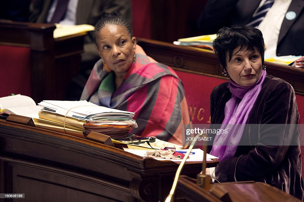 French Justice Minister Christiane Taubira (L) and Junior Minister for Family Dominique Bertinotti take part in the debate to allow gay couples to get married and adopt children on February 4, 2013 at the National Assembly in Paris. Two days before, Members of Parliament voted 249-97 in favour of Article One of the draft law, which redefines marriage as being a contract between two people rather than necessarily between a man and a woman. AFP PHOTO JOEL SAGET