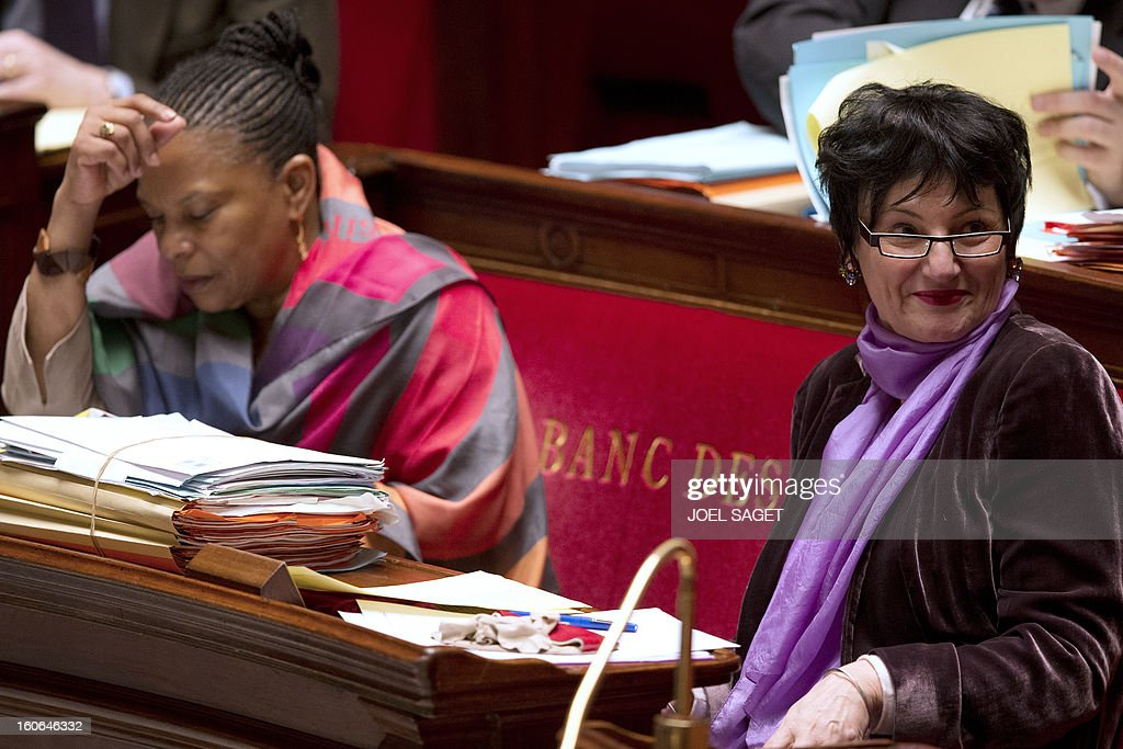 French Justice Minister Christiane Taubira and Junior Minister for Family Dominique Bertinotti take part in the debate to allow gay couples to get married and adopt children on February 4, 2013 at the National Assembly in Paris. Two days before, Members of Parliament voted 249-97 in favour of Article One of the draft law, which redefines marriage as being a contract between two people rather than necessarily between a man and a woman. AFP PHOTO JOEL SAGET