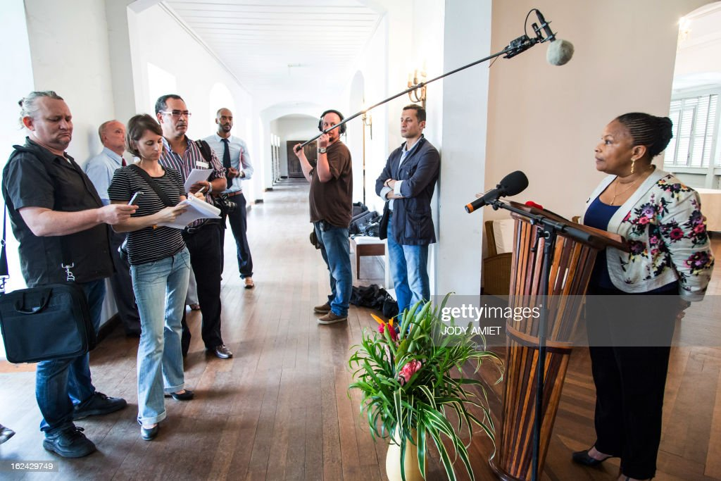 French Justice Minister Christiane Taubira (R) answers journalists' questions on February 23, 2013, during a five-day official visit in Guiana.
