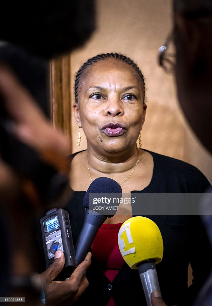 French Justice Minister Christiane Taubira answers to journalists questions as she arrives, on February 21, 2013 at the Cayenne's airport in Matoury, to begin a five-day official visit in the French overseas territory of Guiana.