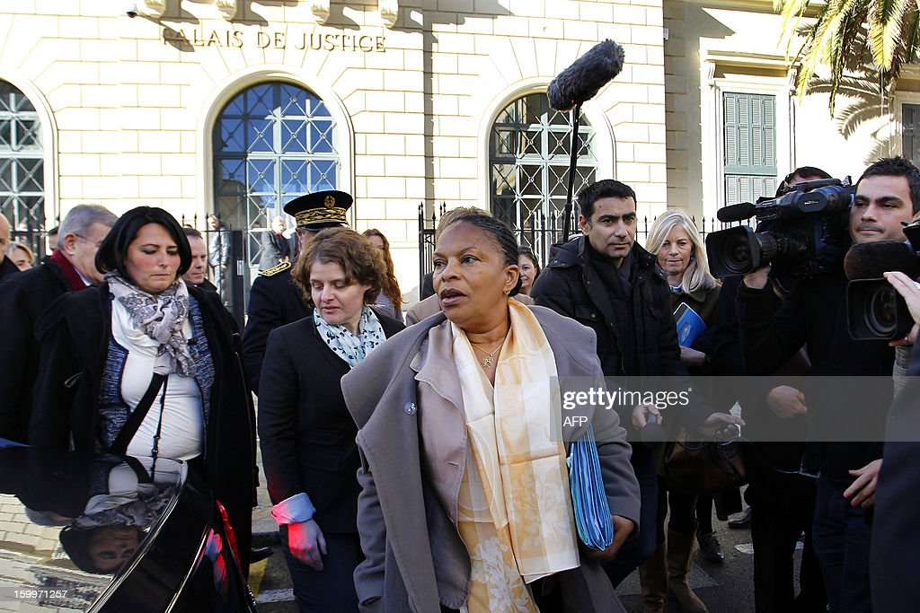French Justice Minister Christiane Taubira (C) arrives at the Ajaccio's court on January 24, 2013, in Ajaccio, French mediterranean island of Corsica.
