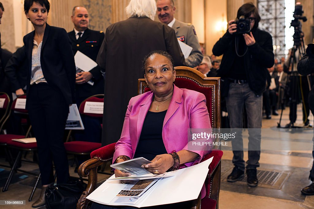 French Justice Minister Christiane Taubira (C) attends a ceremony on January 14, 2013 in Lyon, in central France, to inaugurate the Courthouse after a four-year revamp, during a formal sitting of the appeal court. At left is pictured French Minister for Women's Rights and Government Spokeperson, Najat Vallaud-Belkacem. AFP PHOTO PHILIPPE MERLE