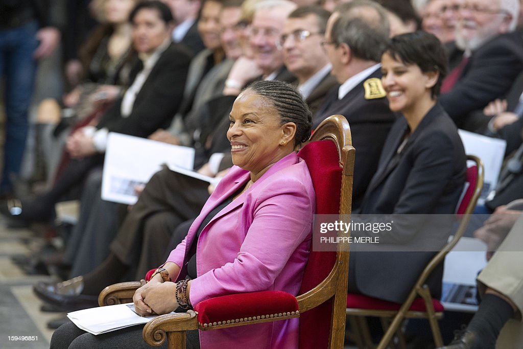 French Justice Minister Christiane Taubira (C) attends a ceremony on January 14, 2013 in Lyon, in central France, to inaugurate the Courthouse after a four-year revamp, during a formal sitting of the appeal court. At right in the backround is pictured French Minister for Women's Rights and Government Spokeperson, Najat Vallaud-Belkacem.