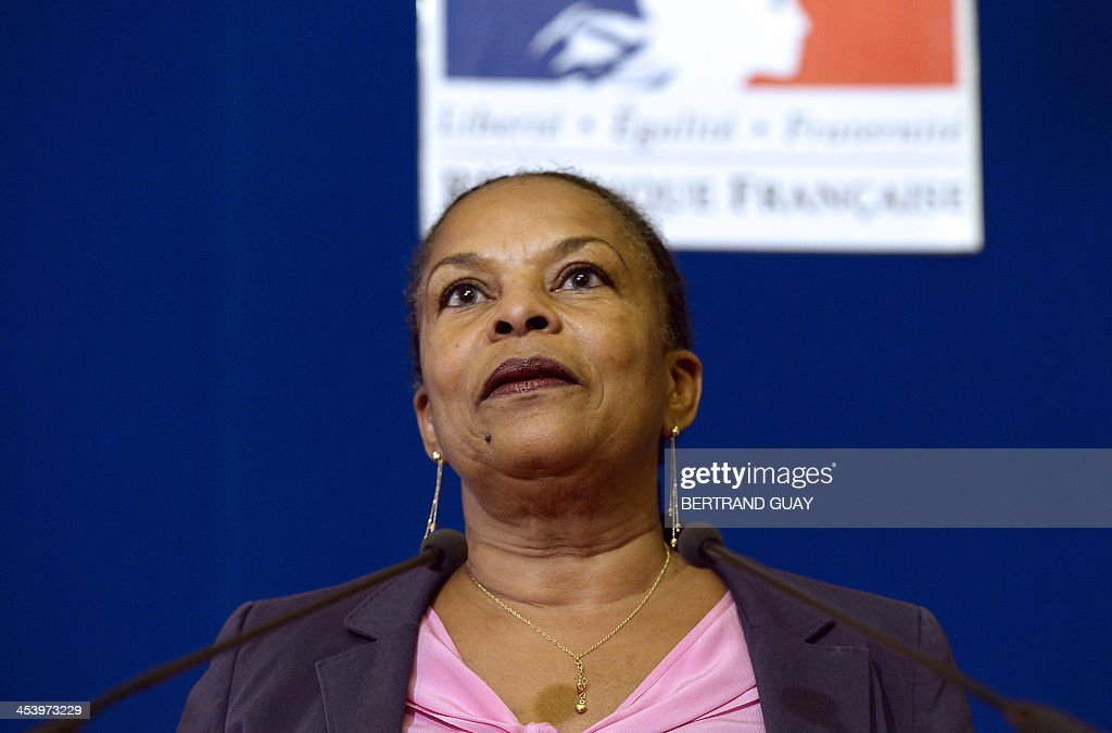 French Justice minister Christiane Taubira delivers a speech in tribute to late South African anti-apartheid icon Nelson Mandela in Paris, on December 6, 2013. The revered icon of the anti-apartheid struggle in South Africa and one of the towering political figures of the 20th century died on December 5, 2013 at age 95. Mandela, who was elected South Africa's first black president after spending nearly three decades in prison, had been receiving treatment for a lung infection at his Johannesburg home since September, after three months in hospital in a critical state.
