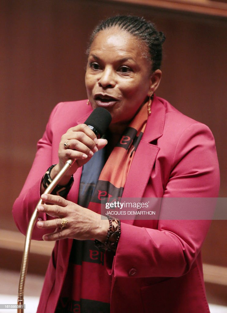 French Justice Minister Christiane Taubira (R) delivers a speech on February 12, 2013 at the French National Assembly in Paris, following a vote by a clear majority to adopt legislation allowing homosexual couples to marry and adopt children. The formal vote came 10 days after lawmakers voted overwhelmingly in favour of its key article which redefines marriage as a contract between two people rather than between a man and a woman. The law will now go for approval by the upper house of parliament.