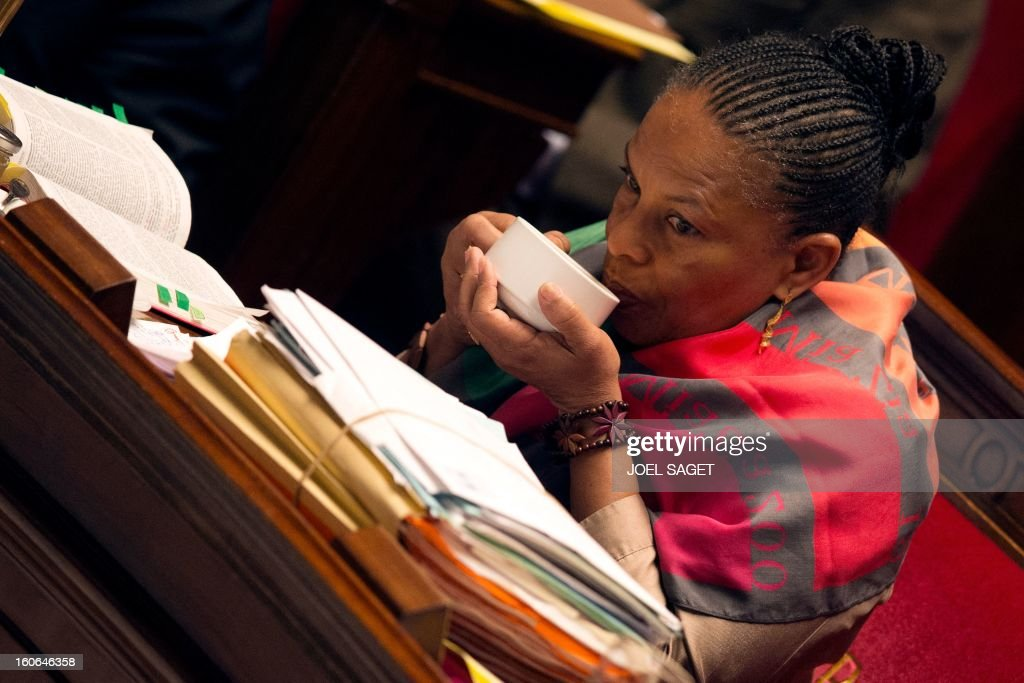 French Justice Minister Christiane Taubira drinks in a cup while taking part in the debate to allow gay couples to get married and adopt children on February 4, 2013 at the National Assembly in Paris. Two days before, Members of Parliament voted 249-97 in favour of Article One of the draft law, which redefines marriage as being a contract between two people rather than necessarily between a man and a woman.
