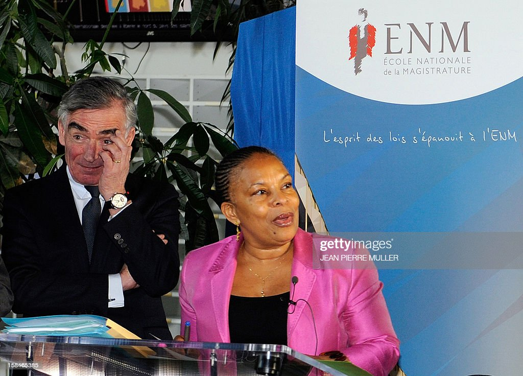 French Justice Minister Christiane Taubira (C), flanked by Jean-Claude Marin, General Prosecutor at the Cour of Cassation (French highest court), delivers a speech at the French Ecole de la Magistrature (ENM, a Judicial Academy) in Bordeaux, southwestern France, on December 17, 2012, prior to a meeting with future judges. The slogan reads : 'The spririt of law blooms at the ENM' referring to the title of a book of French jurist Montesquieu (XVIIIth century).