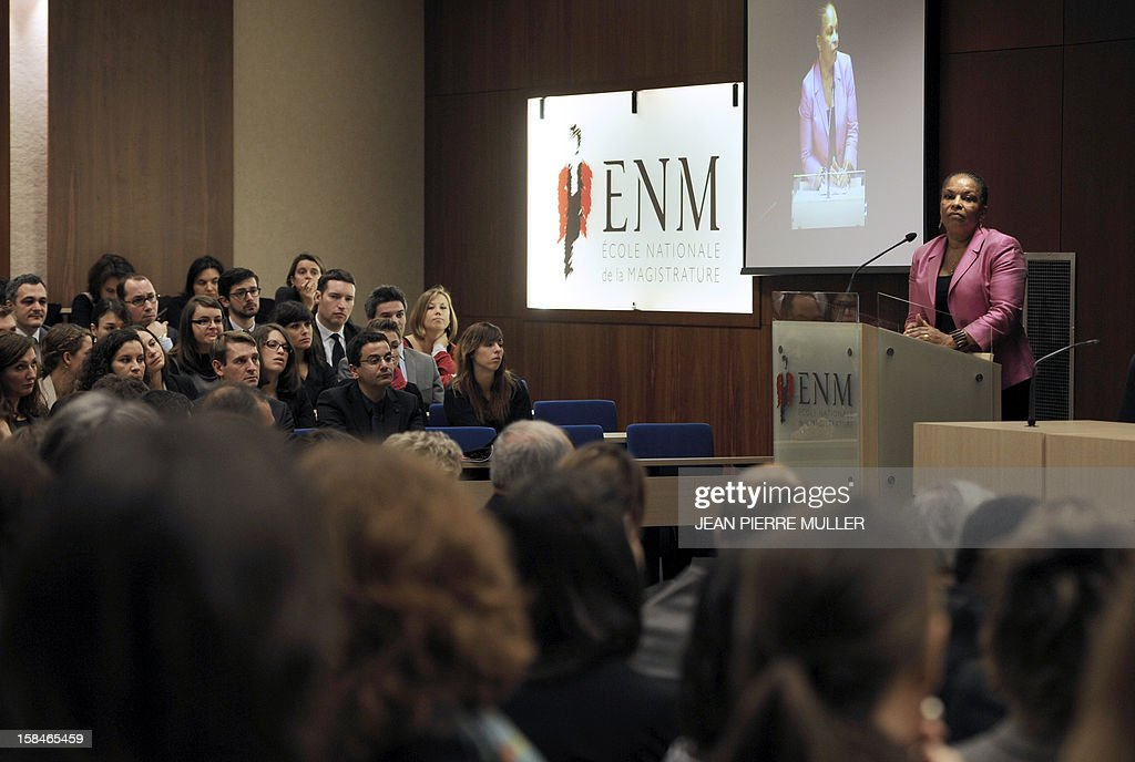 French Justice Minister Christiane Taubira (C), flanked by Jean-Claude Marin, General Prosecutor at the Cour of Cassation (French highest court), delivers a speech at the French Ecole de la Magistrature (ENM, a Judicial Academy) in Bordeaux, southwestern France, on December 17, 2012, prior to a meeting with future judges.