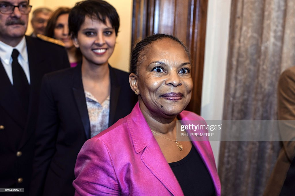 French Justice Minister Christiane Taubira (C), followed by French Minister for Women's Rights and Government Spokeperson, Najat Vallaud-Belkacem, arrives to a ceremony on January 14, 2013 in Lyon, in central France, to inaugurate the Courthouse after a four-year revamp, during a formal sitting of the appeal court.